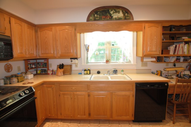 Central kitchen with oak cabinets