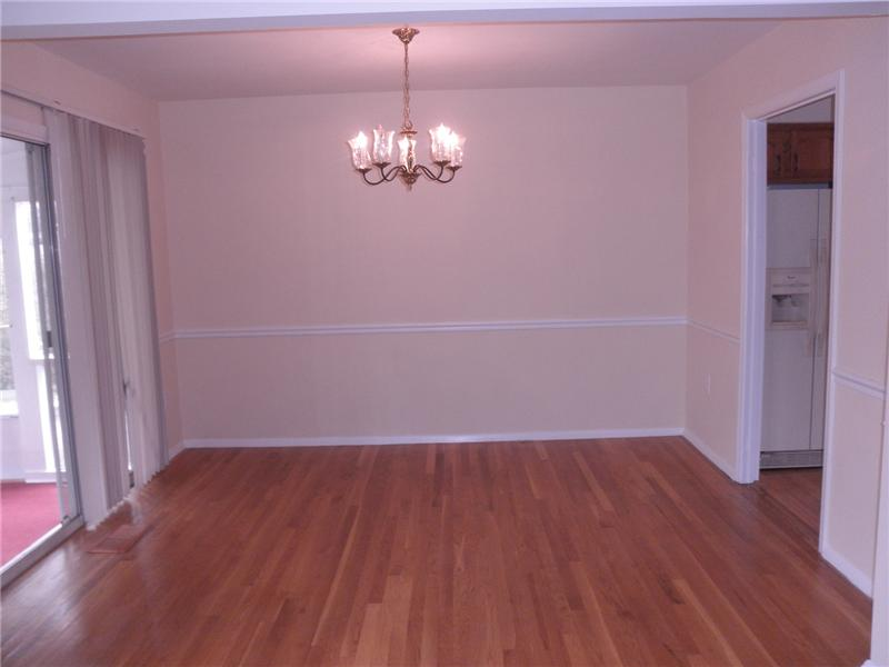 Separate dining room with wood floors