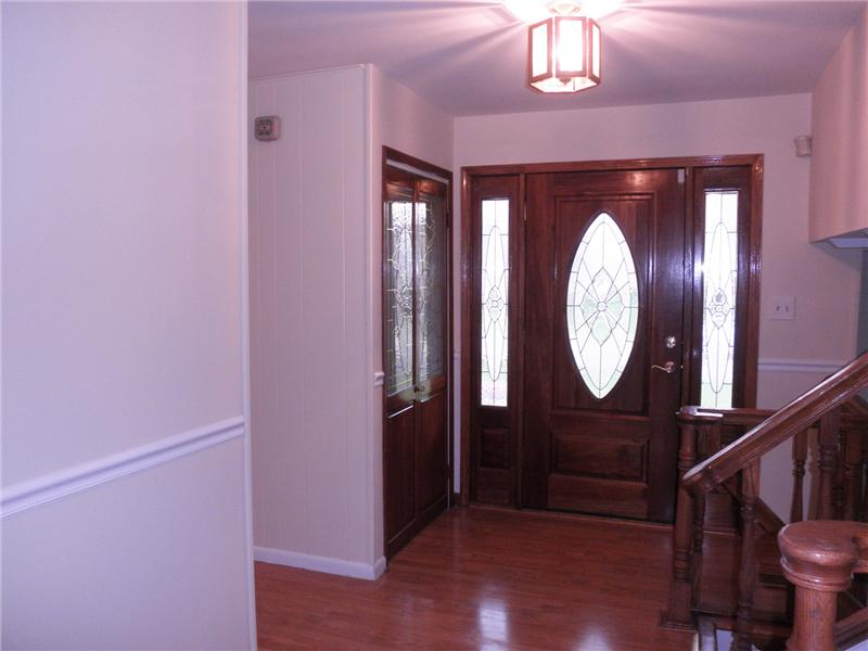 Entry foyer with wood floors