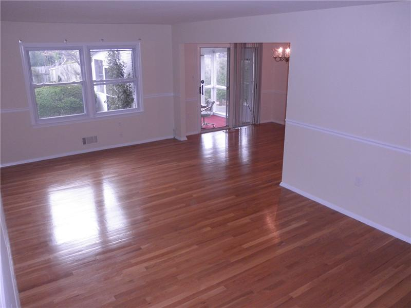 Spacious living room with wood floors
