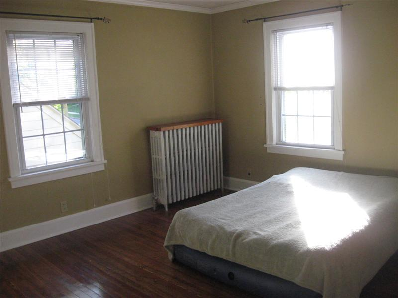 Master bedroom with hardwood floors and ceiling fan