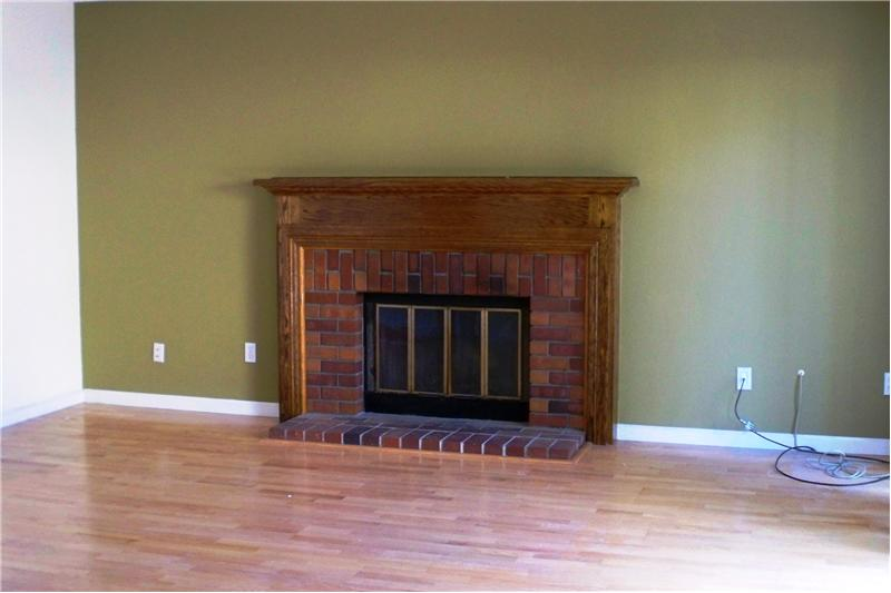 Living Room - Wood Burning Fireplace