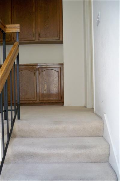 Cabinets at top of stairs