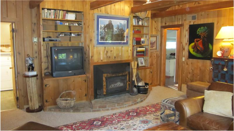 Fireplace and built-in shelves in family room