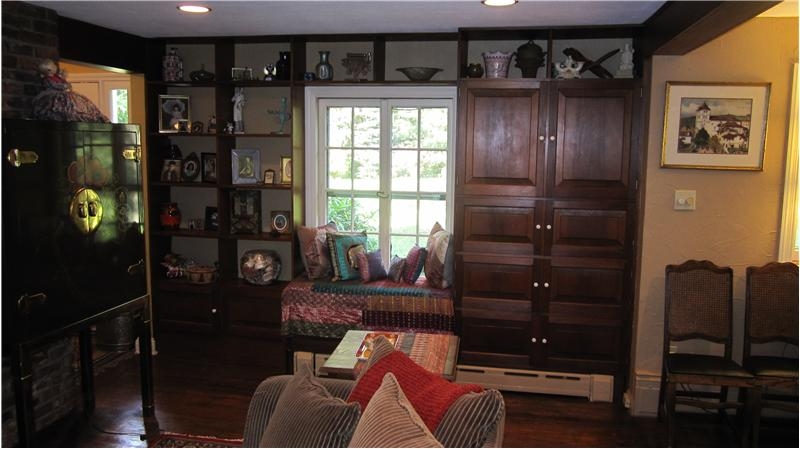 Built-in window seats with open and closed shelving