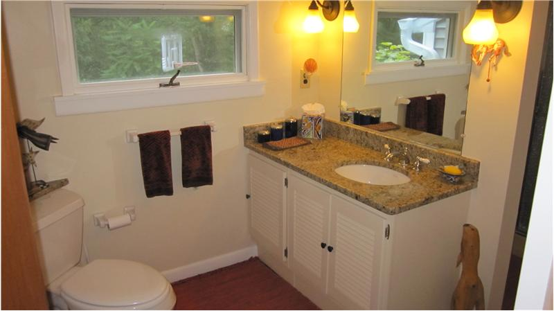 Full bathroom on main level with granite countertop
