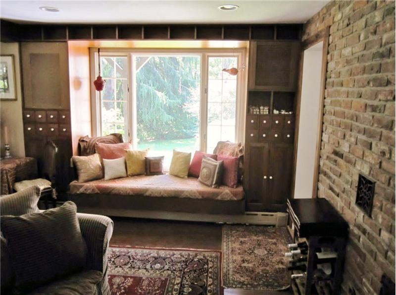 Built-in window seat with speakers and storage surrounding